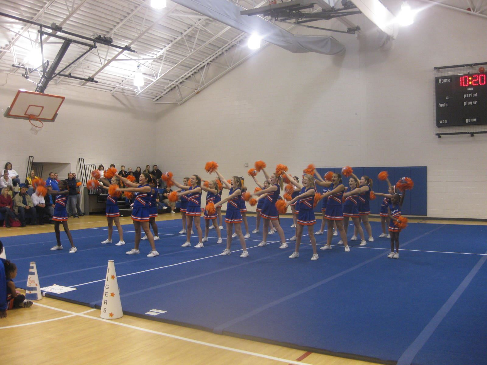 A group of cheerleaders doing a cheer routine.